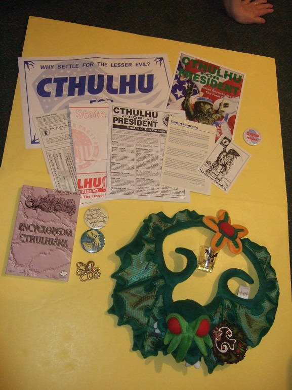Image for CTHULHU GROUPING: Encyclopedia Cthulhiana  / Cthulhu for President 1992 / Cthulhu Christmas Wreath / Cthulhu Shotglass  & Pinback Buttons ( ( H P Lovecraft / Cthulhu Mythos related) book includes: History of the Necronomicon )