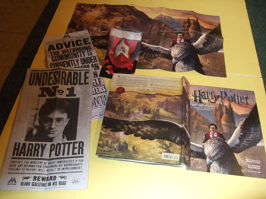 "Image for Harry Potter, a Pop-Up Book ( PopUps Include:  Diagon Alley; Hogwarts School; Aragog  and Buckbeak; a Hungarian Horntail Dragon; Voldemort and the Angel of Death ans includes Wanted Poster, 23"" x 13"" Poster, a Howler; etc)"